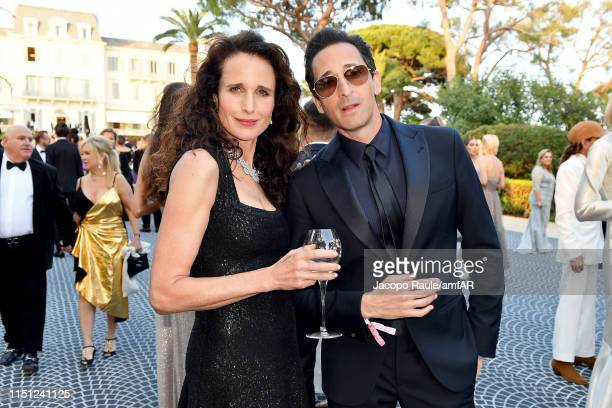 Andie MacDowell and Andrien Brody attend the amfAR Cannes Gala 2019 at Hotel du CapEdenRoc on May 23 2019 in Cap d'Antibes France