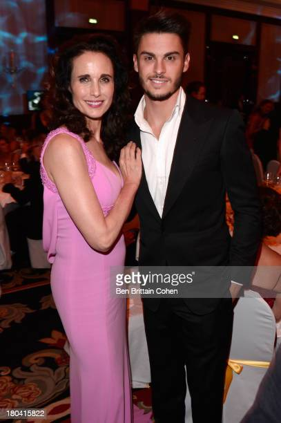Andie MacDowell and Baptiste Giabiconi attend the Dreamball 2013 charity gala at Ritz Carlton on September 12 2013 in Berlin Germany