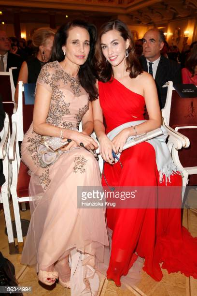 Andie MacDowell and daughter Rainey Qualley attend the Prix Montblanc 2013 at Konzerthaus Am Gendarmenmarkt on October 30 2013 in Berlin Germany