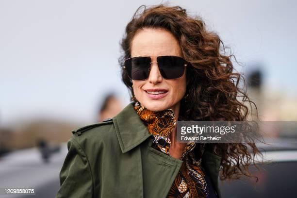 Andie MacDowell wears sunglasses, a green khaki coat, a floral print shirt, outside Dior, during Paris Fashion Week - Womenswear Fall/Winter...