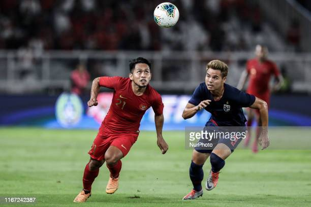 Andik Vermansah of Indonesia's in action with Theerathon Bunmathan of Thailand's during FIFA World Cup 2022 qualifying match between Indonesia and...