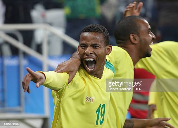 Andile Fikizolo of South Africa celebrates after teammate Gift Motupa scored a goal during the Men's First Round Group A match between South Africa...