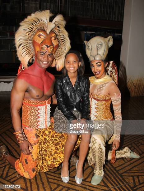 Andile Gumbi as 'Simba' Quvenzhane Wallis and Chantel Riley as 'Nala' pose backstage at the hit musical 'The Lion King' on Broadway at The Minskoff...