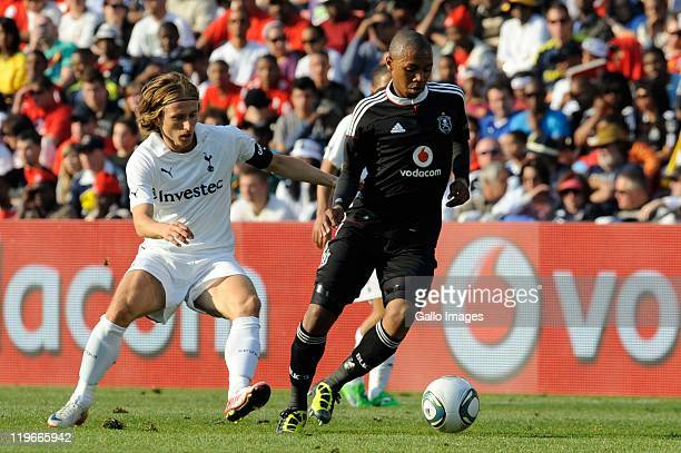 Andile Jali of Pirates and Luka Modric of Tottenham compete during the 2011 Vodacom Challenge final match between Orlando Pirates and Tottenham...