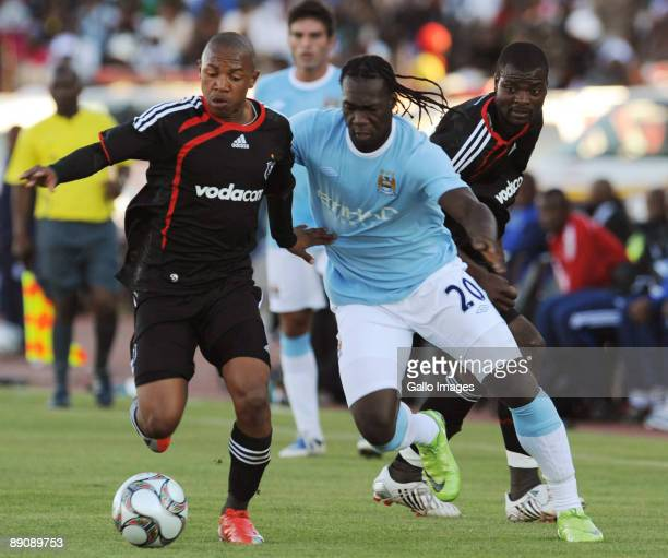 Andile JaliFelipe Caicedo and Rooi Mahamutsa in action during the 2009 Vodacom Challenge match between Orlando Pirates and Manchester City from Peter...