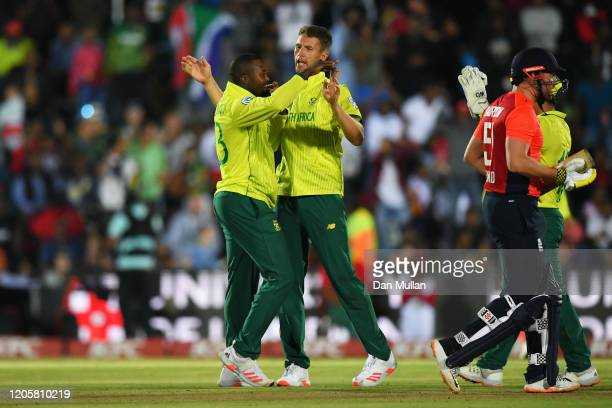 Andile Phehlukwayo and Dwaine Pretorius of South Africa celebrate dismissing Jonny Bairstow of England during the First T20 International match...