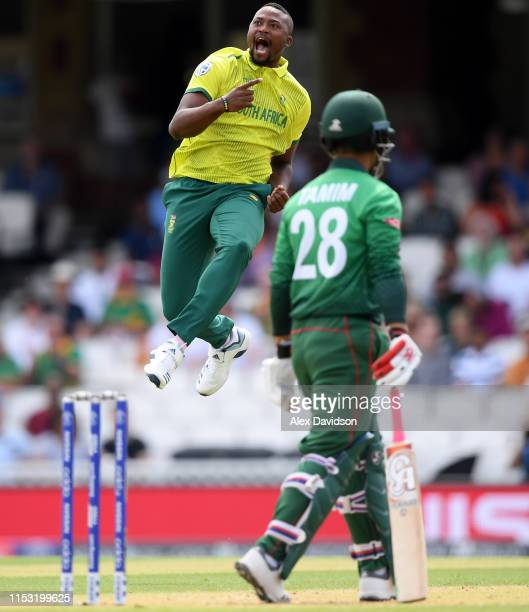Andile Phehlukwayo of South Africa celebrates taking the wicket of Tamim Iqbal of Bangladesh during the Group Stage match of the ICC Cricket World...