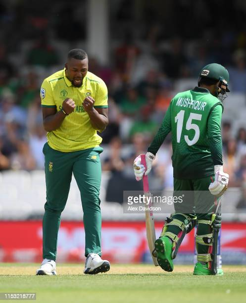 Andile Phehlukwayo of South Africa celebrates taking the wicket of Mushfiqur Rahim of Bangladesh during the Group Stage match of the ICC Cricket...