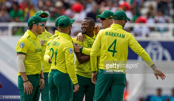 Andile Phehlukwayo of South Africa celebrates with his team mates after taking the wicket of Tamim Iqbal of Bangladesh during the Group Stage match...