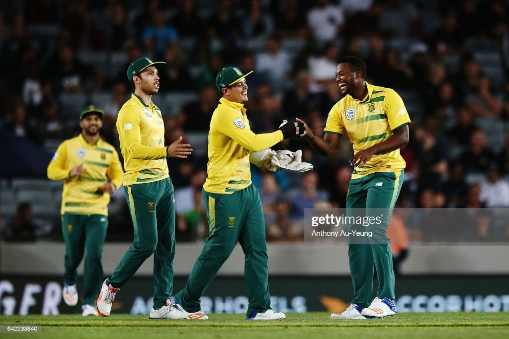 Andile Phehlukwayo of South Africa celebrates with teammate Quinton de Kock after dismissing Corey Anderson of New Zealand during the first International Twenty20 match between New Zealand and South Africa at Eden Park on February 17, 2017 in Auckland, New Zealand.