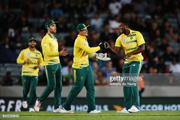 Andile Phehlukwayo of South Africa celebrates with teammate Quinton de Kock after dismissing Corey Anderson of New Zealand during the first...