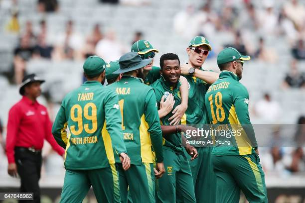 Andile Phehlukwayo of South Africa celebrates with teammates for the wicket of Dean Brownlie of New Zealand during game five of the One Day...