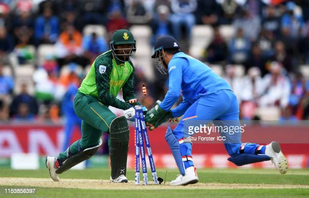 Andile Phehlukwayo of South Africa is stumped by MS Dhoni of India during the Group Stage match of the ICC Cricket World Cup 2019 between South...