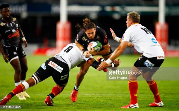 Andisa Ntsila of the Toyota Cheetahs tackling Marius Louw of the Cell C Sharks during the Super Rugby Unlocked match between Cell C Sharks and Toyota...