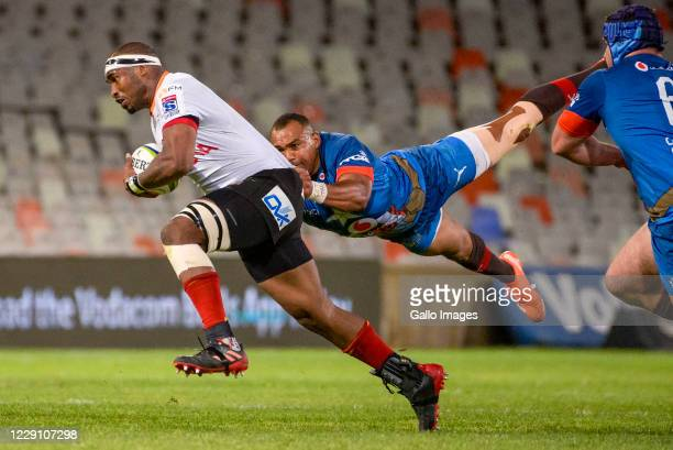 Andisa Ntsila of Toyota Cheetahs tackled by Cornal Hendricks of Vodacom Bulls during the Super Rugby Unlocked match between the Toyota Cheetahs and...