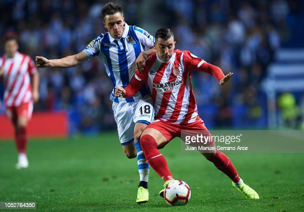 Andoni Gorosabel of Real Sociedad competes for the ball with Borja Garcia of Girona FC during the La Liga match between Real Sociedad and Girona FC...