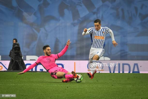 Andoni Gorosabel of Real Sociedad duels for the ball with Postigo of Levante during the Spanish league football match between Real Sociedad and...