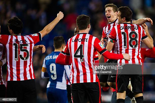 Andoni Iraola Aymeric Laporte Iker Muniain and Carlos Gurpegi of Athletic Club celebrate after the Copa del Rey SemiFinal Second Leg match between...