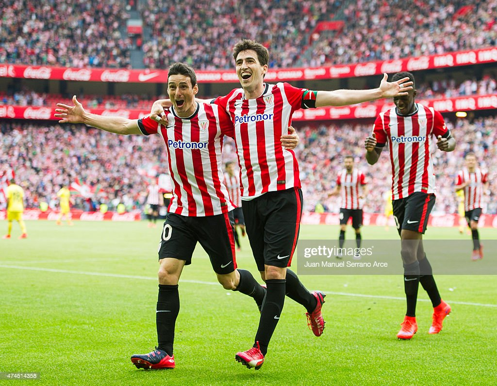 Andoni Iraola of Athletic Club celebrates with his teammate Aritz Aduriz of Athletic Club after scoring his team's second goal during the La Liga match between Athletic Club Bilbao and Villarreal at San Mames Stadium on May 23, 2015 in Bilbao, Spain.