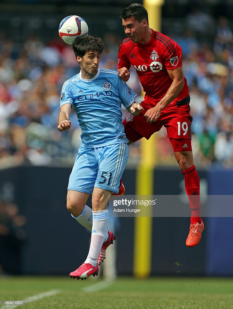 Andoni Iraola #51 of New York City FC battles for the ball with Daniel Lovitz #19 of Toronto FC during a soccer game at Yankee Stadium on July 12, 2015 in the Bronx borough of New York City.