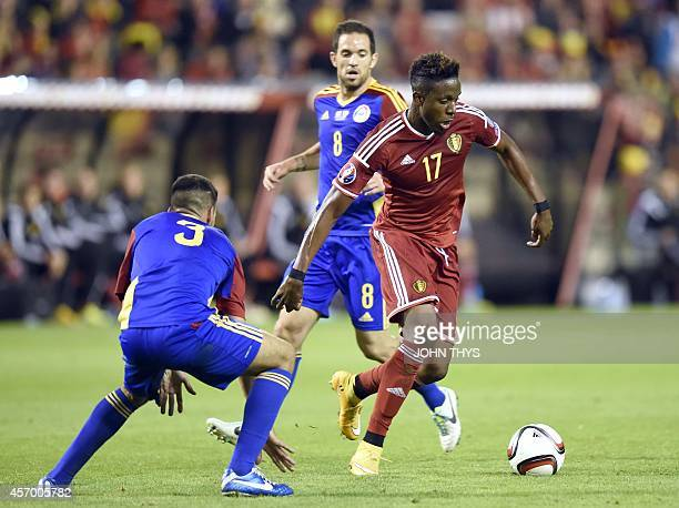 Andorra defender Marc Vales vies for the ball Belgium's forward Divock Origi during the Euro 2016 qualifying round football match between Belgium and...