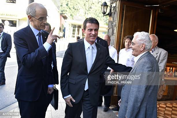 Andorran Prime Minister Antoni Marti Petit and French Prime Minister Manuel Valls speak with a local man on June 19 2015 during the French PM's visit...