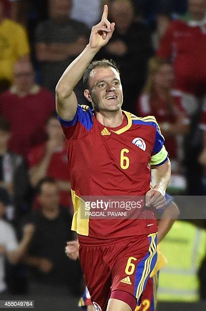 Andorra's defender Ildefons Lima celebrates after scoring a goal during the Euro 2016 qualifying round football match Andorra vs Wales on September 9...