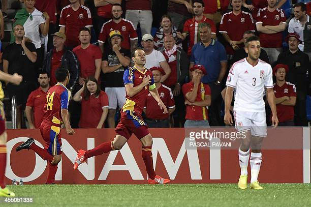Andorra's defender Ildefons Lima followed by teammate midfielder Carlos Peppe celebrates after scoring a goal as Wales defender Neil Taylor looks on...