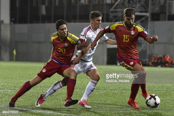 Andorra's defender Moises San Nicolas and Andorra's defender Max Llovera vie with Hungary's forward Roland Sallai during the FIFA World Cup 2018...