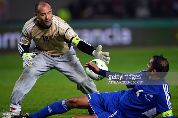 Andorra's defender Oscar Sonejee vies with Hungary's goalkeeper Gabor Kiraly during the FIFA 2014 World Cup group D qualifying football match Hungary...