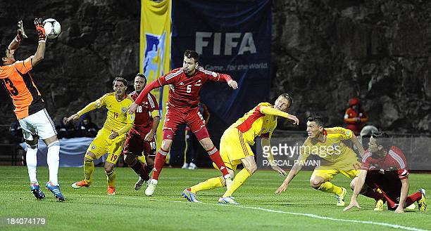 Andorra's Goalkeeper Ferran Pol jumps for the ball during the 2014 FIFA World Cup group D qualifying football match between Andorra and Romania on...