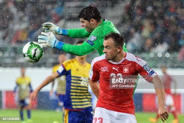 Andorra's goalkeeper Josep Gomes vies with Swiss midfielder Xherdan Shaqiri during the 2018 FIFA World Cup qualifying football match between...