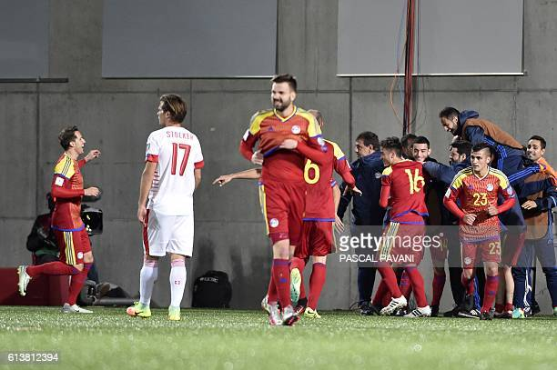 Andorra's midfielder Alexandre Martinez celebrates with teammates after scoring during the FIFA World Cup 2018 football qualifier between Andorra and...