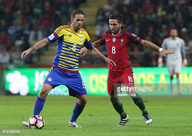 Andorra's midfielder Marcio Vieira with Portugal's midfielder Joao Moutinho in action during the FIFA 2018 World Cup Qualifier match between Portugal...