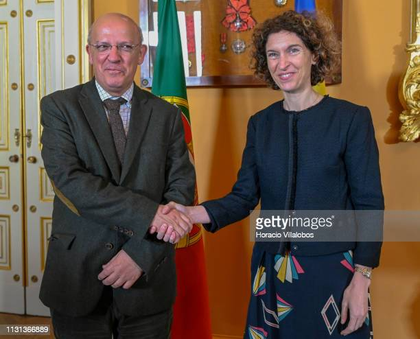 Andorra's Minister of Foreign Affairs Maria Ubach and Portuguese Foreign Minister Augusto Santos Silva smile and shake hands at the end of their...