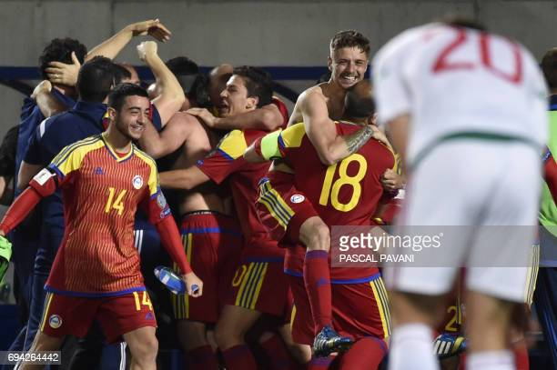 Andorra's players celebrate winning at the end of the FIFA World Cup 2018 football qualifier between Andorra and Hungary at the Municipal Stadium in...