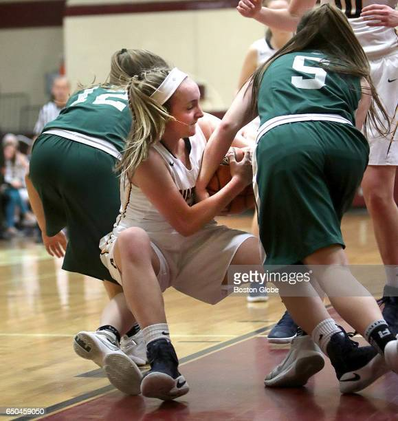 Andover High School's Alexa Pacy battles Billerica's Madison Bonvie and Nicole Wedge during a Div I girls semifinal basketball game played at...