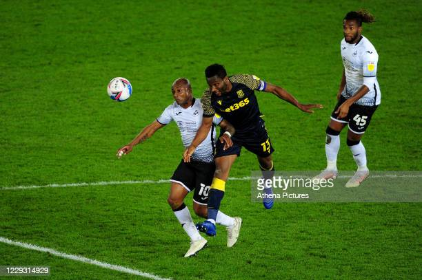 André Ayew of Swansea City battles with John Obi Mikel of Stoke City during the Sky Bet Championship match between Swansea City and Stoke City at the...