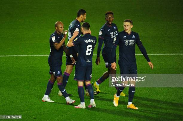 André Ayew of Swansea City celebrates scoring his side's equalising goal to make the score 11 during the Sky Bet Championship match between Coventry...
