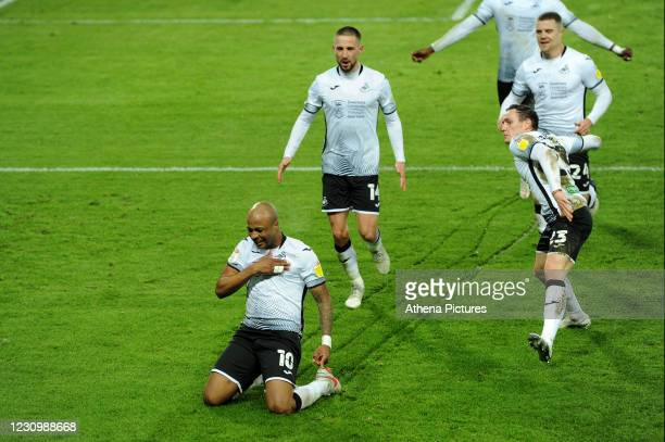 André Ayew of Swansea City celebrates scoring the opening goal during the Sky Bet Championship match between Swansea City and Norwich City at the...
