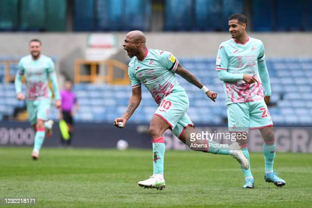 André Ayew of Swansea City celebrates scoring the opening goal during the Sky Bet Championship match between Millwall and Swansea City at The Den on...