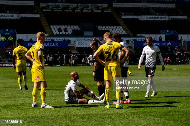 André Ayew of Swansea City goes down with an injury during the Sky Bet Championship match Swansea City and Wycombe Wanderers at Liberty Stadium on...