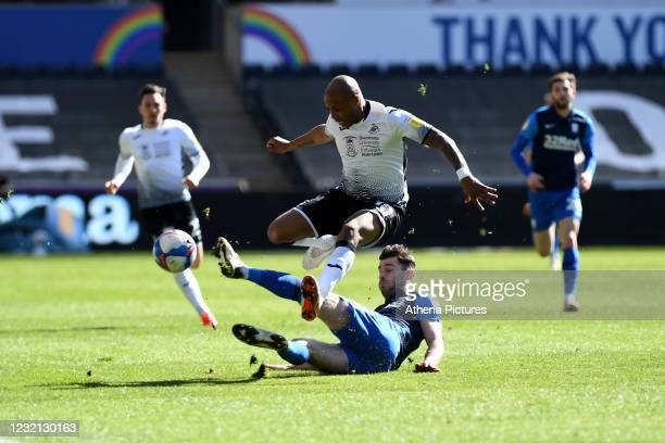 André Ayew of Swansea City is tackled by Andrew Hughes of Preston North End during the Sky Bet Championship match between Swansea City and Preston...