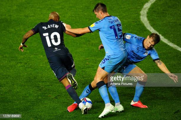 André Ayew of Swansea City is tackled by Kyle McFadzean of Coventry City during the Sky Bet Championship match between Coventry City and Swansea City...