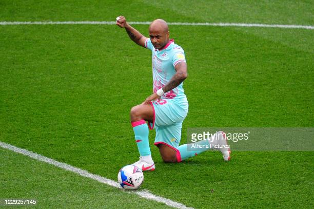 André Ayew of Swansea City takes a knee during the Sky Bet Championship match between Bristol City and Swansea City at Ashton Gate on October 24 2020...