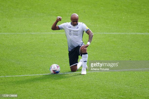 André Ayew of Swansea City takes the knee during the Sky Bet Championship match between Swansea City and Huddersfield Town at the Liberty Stadium on...