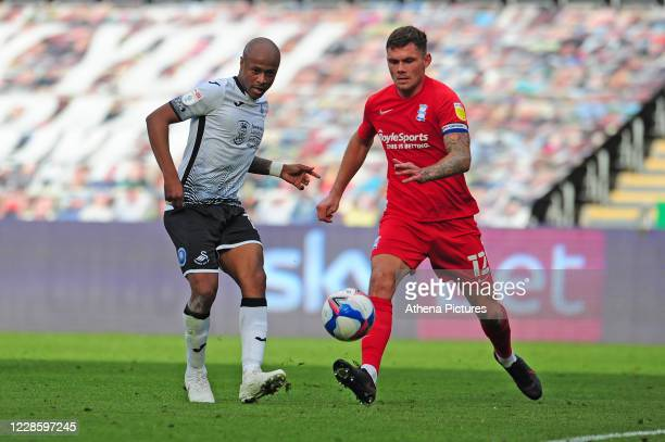 André Ayew of Swansea City vies for possession with Harlee Dean of Birmingham City during the Sky Bet Championship match between Swansea City and...