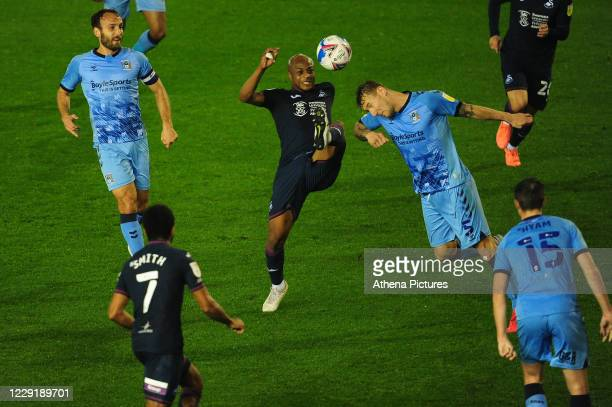André Ayew of Swansea City vies for possession with Kyle McFadzean of Coventry City during the Sky Bet Championship match between Coventry City and...