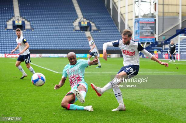 André Ayew of Swansea City vies for possession with Tom Barkhuizen of Preston North End during the Sky Bet Championship match between Preston North...