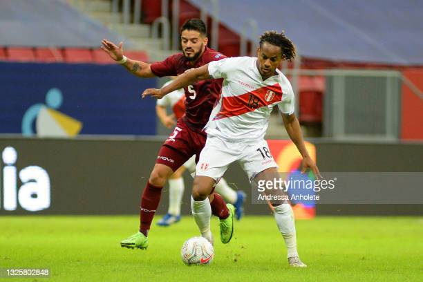 André Carrillo of Peru and Junior Moreno of Venezuela fight for the ball during a Group B Match between Venezuela and Peru as part of Copa America...